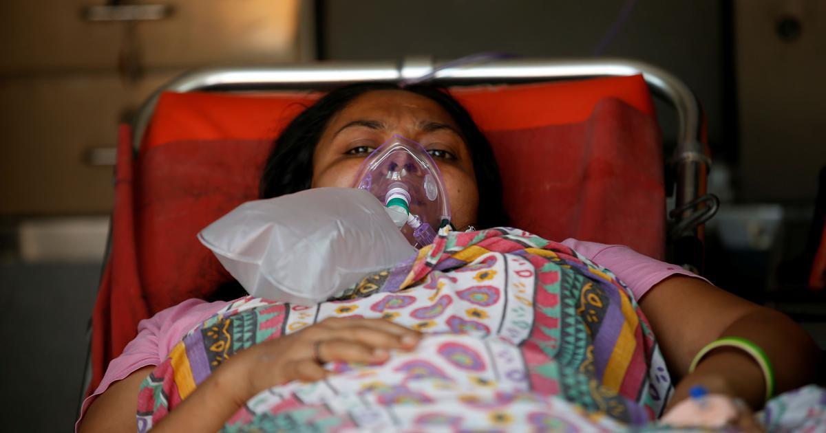 """Bi kịch chất chồng giữa """"địa ngục"""" Ấn Độ: Ông bà mắc Covid-19 tự sát để không lây cho cháu, con gái ra sức dùng miệng hô hấp cứu mẹ sắp chết - Ảnh 4."""