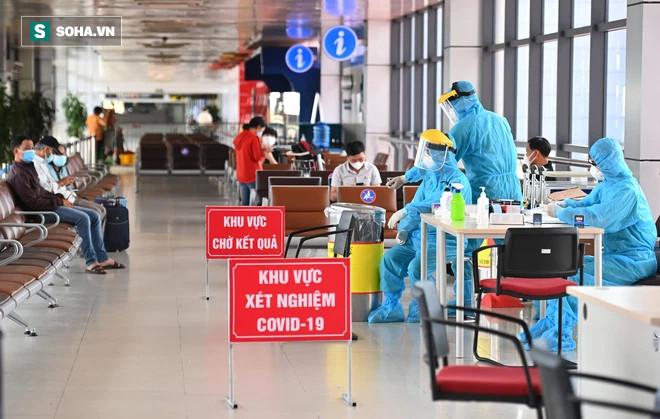 [ẢNH]: Cận cảnh dịch vụ test nhanh Covid-19 trong 30 phút ở sân bay Nội Bài cho hành khách đi TP.HCM - Ảnh 5.