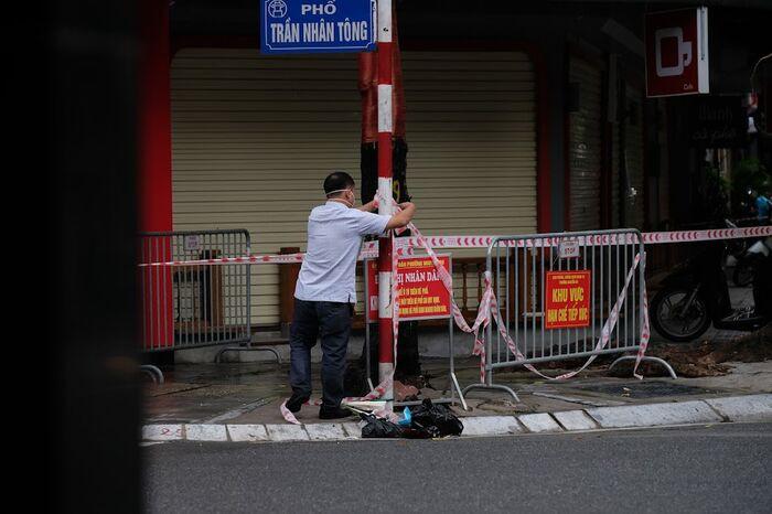 Hà Nội: Phong toả một đoạn phố Trần Nhân Tông sau khi phát hiện ca F0 mới Ảnh 5