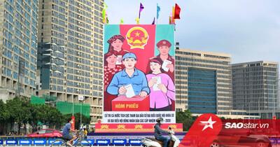 Ảnh: Đường phố Hà Nội rợp sắc cờ hoa, sẵn sàng chào đón ngày bầu cử, ngày hội toàn dân