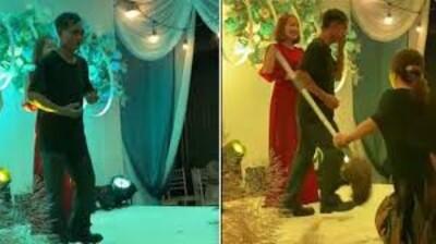 Clip: Đang nhảy nhót trên sân khấu đám cưới, người đàn ông bị vợ cầm chổi đánh khiến hội hôn ngỡ ngàng